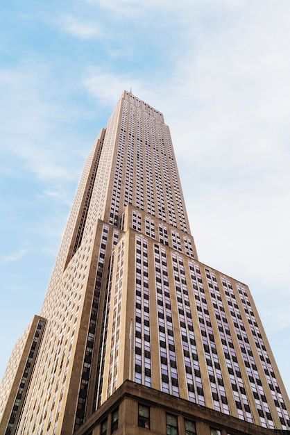 Empire state building on bright sunny day Free Photo