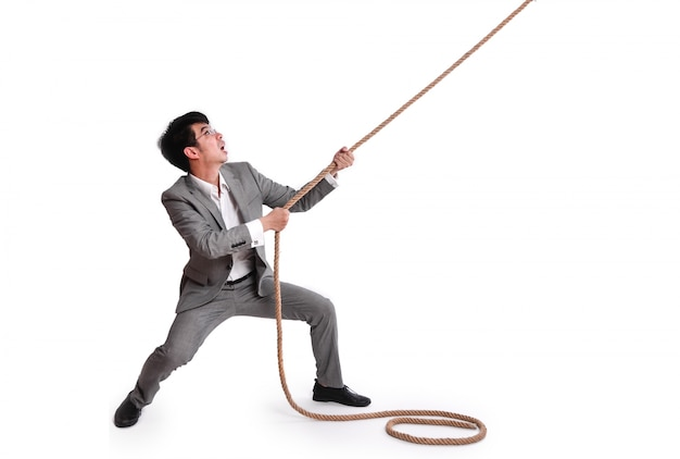 Employee pulling on a rope Free Photo