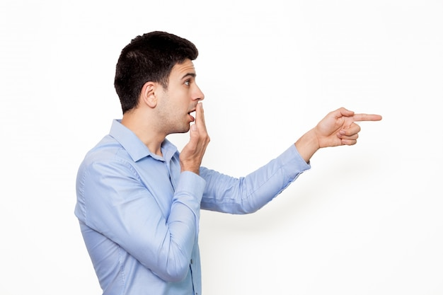 Employee young pointing wondering surprised Free Photo