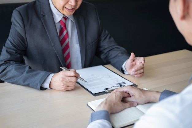 Employer or recruiter holding reading a resume during about colloquy his profile of candidate Premium Photo