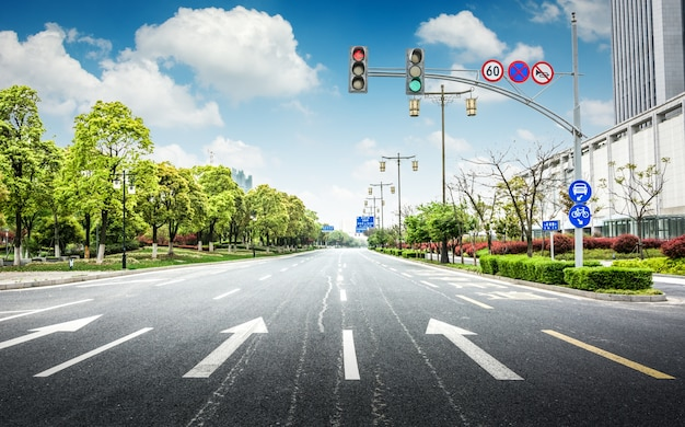 Empty asphalt road through modern city in china. Free Photo