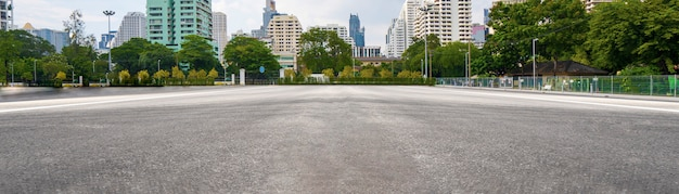 Empty asphalt road with city in the background Premium Photo