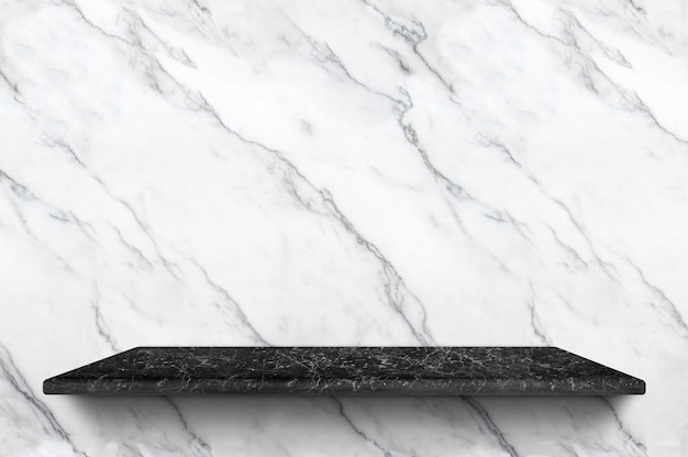Empty black marble shelf at white marble wall background for display product Premium Photo