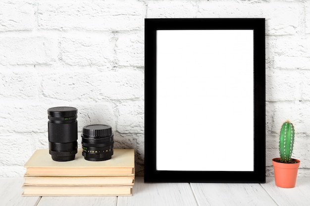 Empty black photo frame on wooden shelf or table. mockup with copy space. Premium Photo