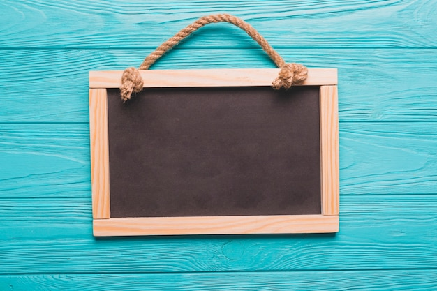 Empty blackboard on turquoise background Free Photo