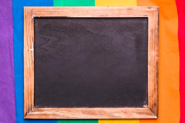 Empty blackboard on rainbow background Free Photo
