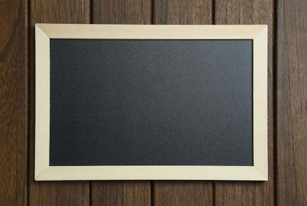 Empty blackboard on vintage wooden background Free Photo