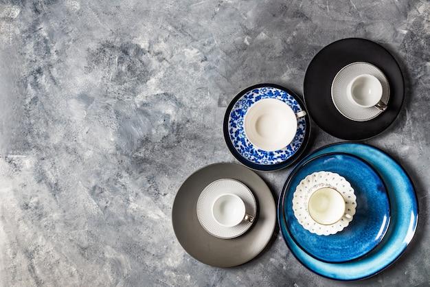 Empty blue plates on grey background Premium Photo