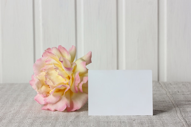 Empty business card and a rose. mockup, scene creator. Premium Photo