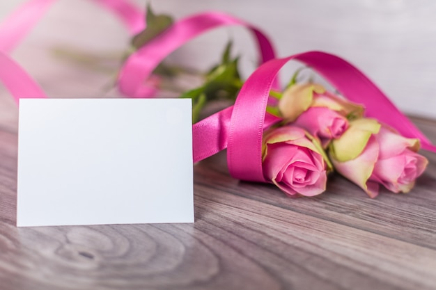 Empty card with roses on wood Free Photo