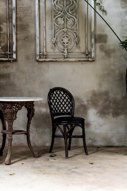 Empty chair and table in vintage room Premium Photo
