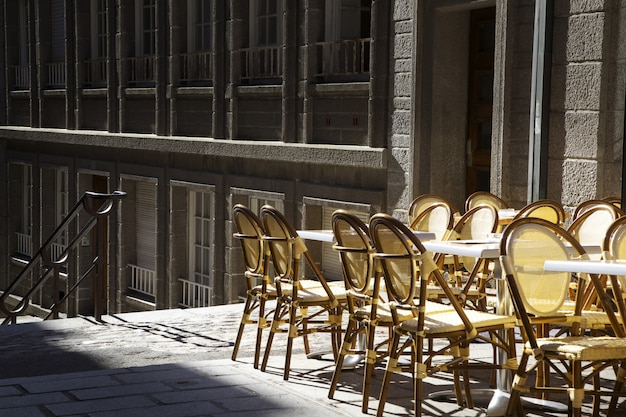 Empty chairs outside the bar in the morning Premium Photo