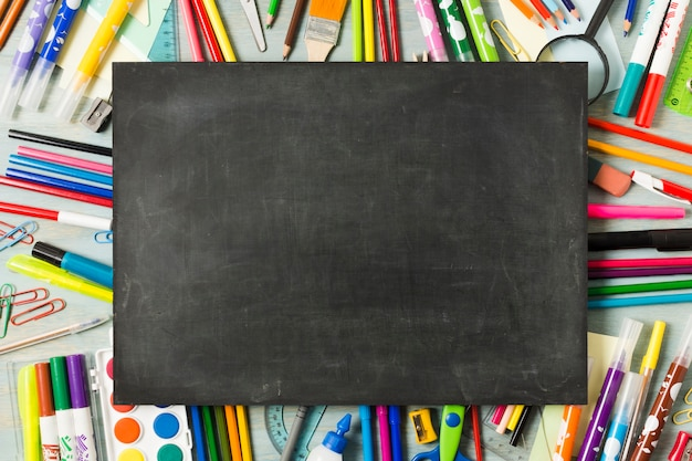 Empty chalkboard on a colourful background Free Photo