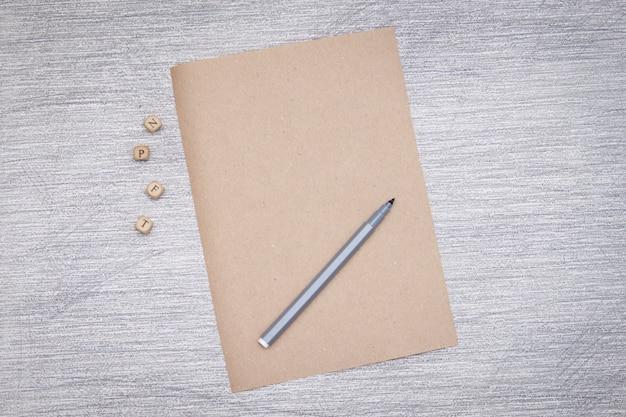 Empty craft paper on grey background Premium Photo