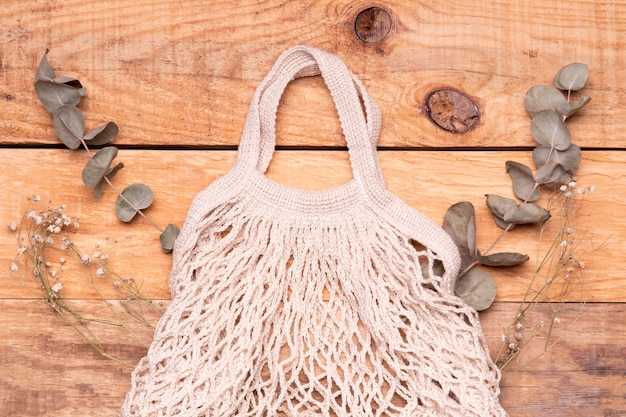 Empty eco friendly bag on wooden background Free Photo