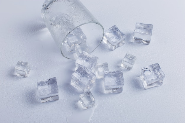 Empty fallen glass with ice Premium Photo