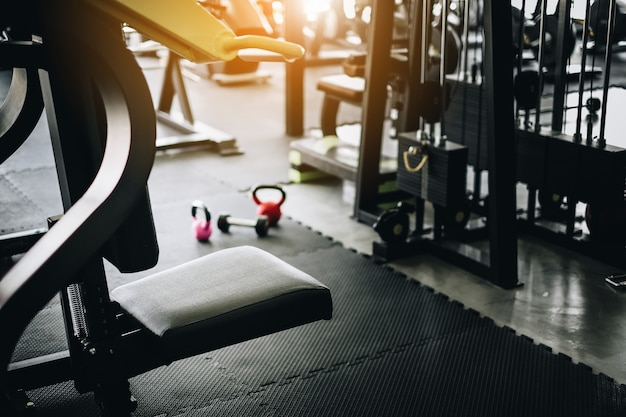 Empty fitness gym with equipment interior at morning with sunrise Premium Photo