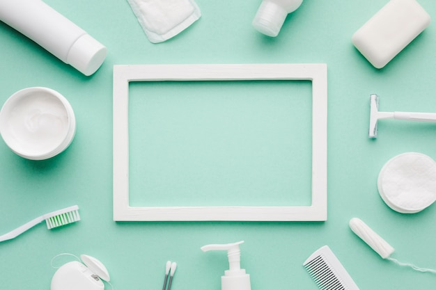 Empty frame surrounded by hygiene products Free Photo