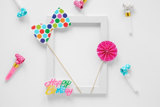 Empty frame with colorful birthday items Free Photo