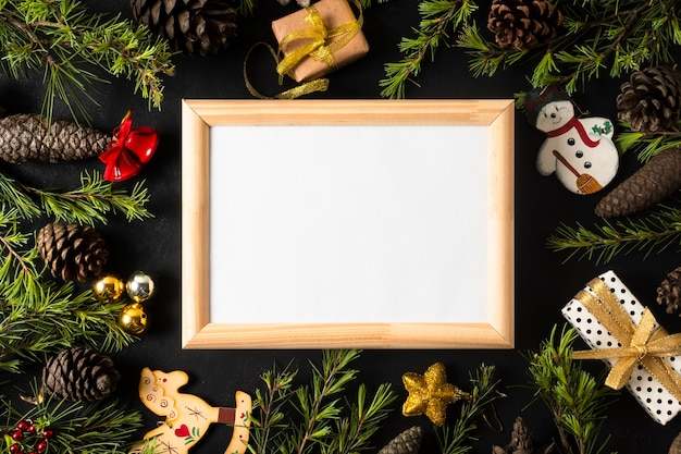 Empty frame with festive christmas ornaments Free Photo