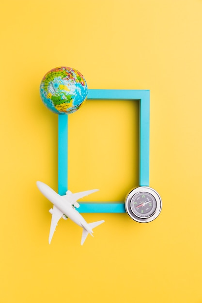 Empty frame with plane and globe Free Photo