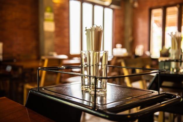 Empty glass in the restaurant.warm light tone in the restaurant. Premium Photo