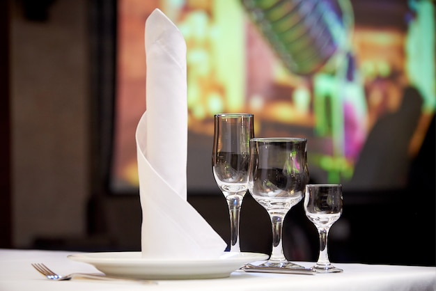 Empty glasses on the banquet table.table setting for a banquet or dinner party. Premium Photo