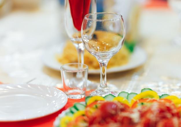 Empty glasses set in restaurant. catering service concept Premium Photo