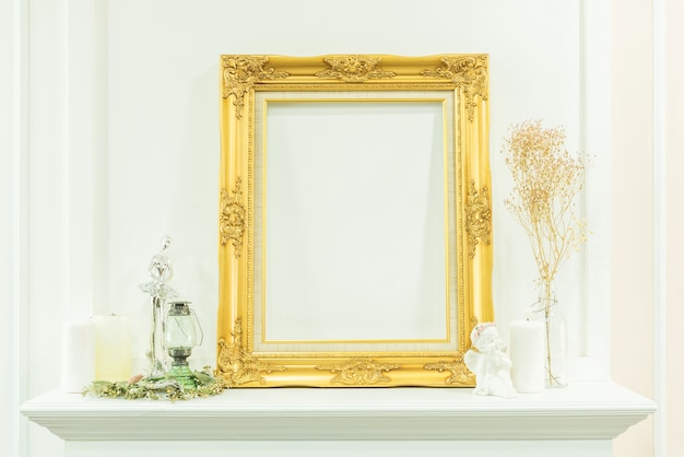 Empty golden photo frame decoration on wall. Photo | Premium Download