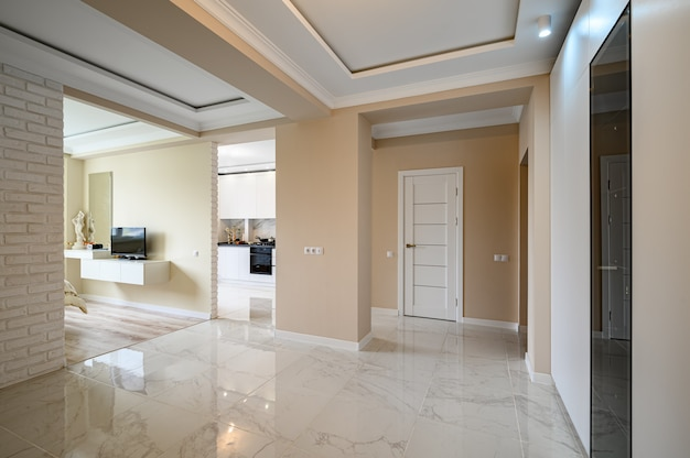 Premium Photo Empty Hallway Of Modern Studio Apartment With White Kitchen And Beige Bedroom