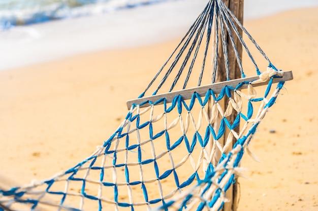 Empty hammock swing on the beautiful beach and sea Free Photo