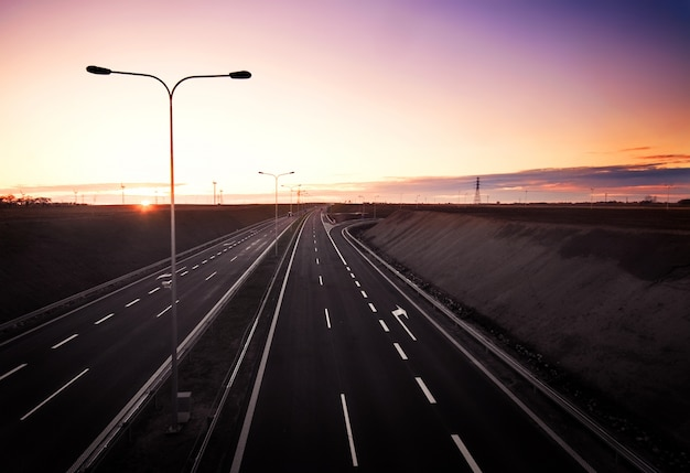 Empty highway at dawn Free Photo
