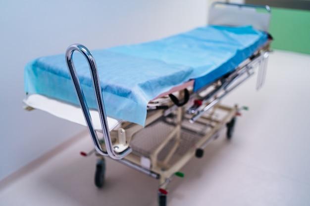 Empty hospital hallway with surgical transport equipment. Premium Photo