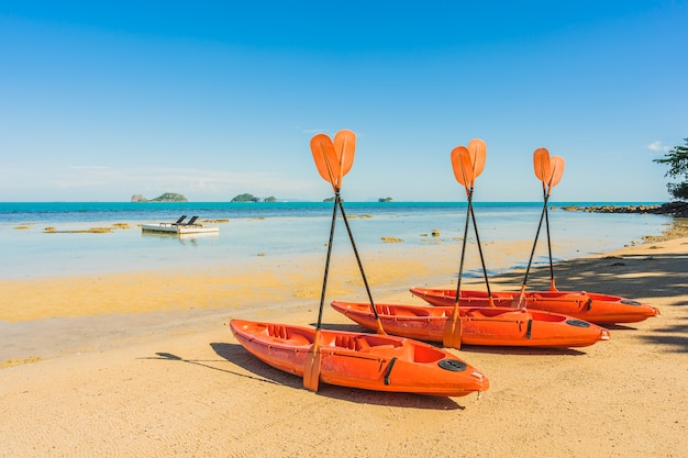 Empty kayak boat or ship on the tropical beach and sea Free Photo