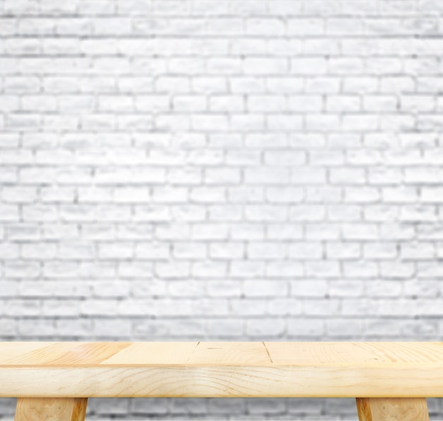Empty light wood table and blur white brick wall in background,mock ...