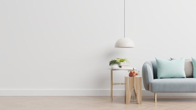 青いソファ、植物、空の白い壁の背景にテーブルが付いている空のリビングルーム。 3dレンダリング 無料写真