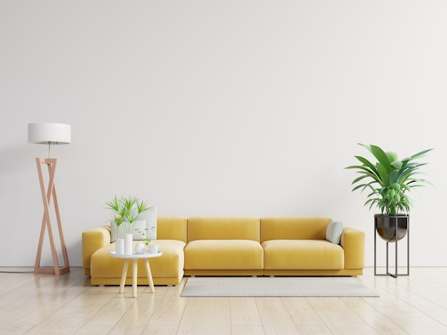Empty living room with yellow sofa, plants and table on empty white wall background. Premium Photo