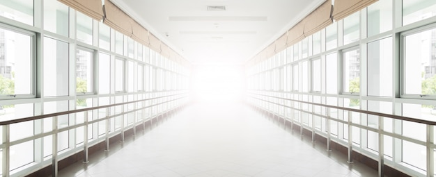 Empty long corridor in the modern office building. background Premium Photo