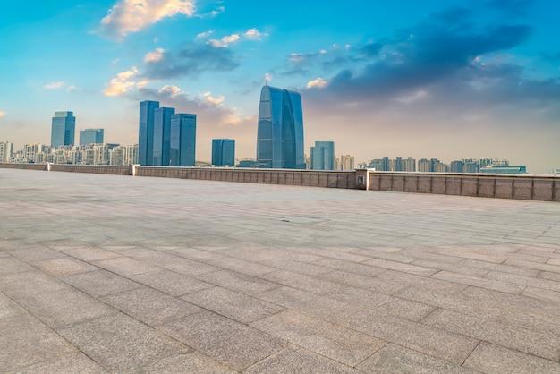 The empty marble floor and the city of suzhou. Premium Photo