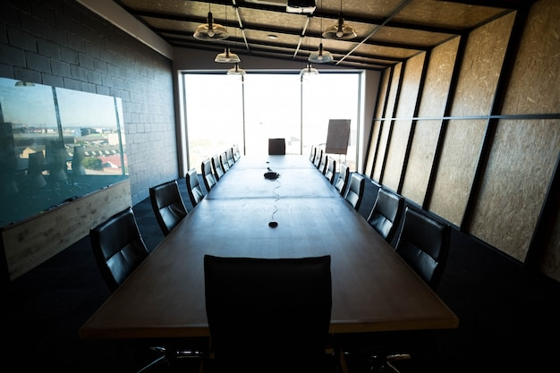 An empty modern conference room and conference table in office Premium Photo