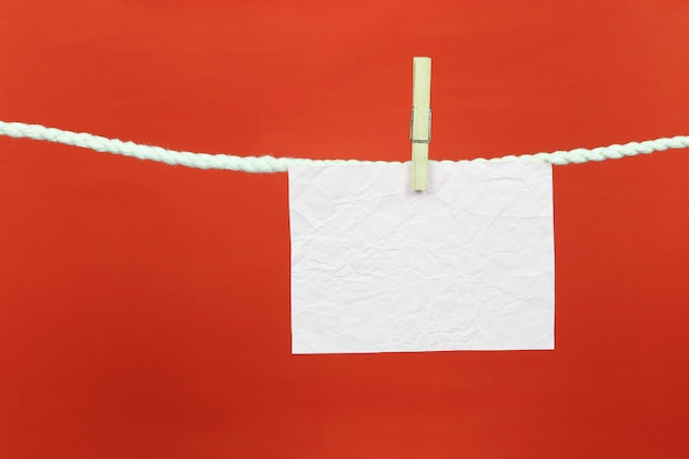 Empty note paper hang on the clothesline. Premium Photo