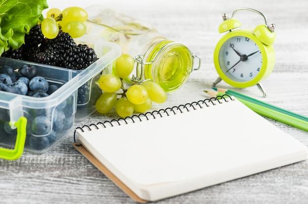 Empty notebook and berries Premium Photo