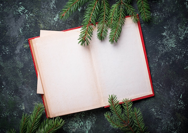 Empty notebook with tree branches. top view Premium Photo