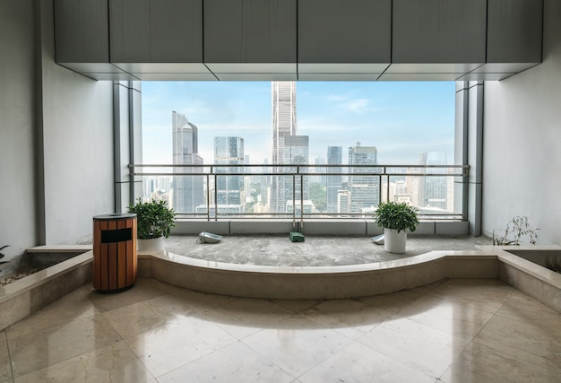 Empty office space and windows outside skyscrapers in shenzhen, china Premium Photo