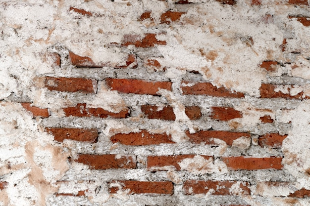 Empty old brick wall texture. painted distressed wall surface. grungy wide brick wall. Premium Photo