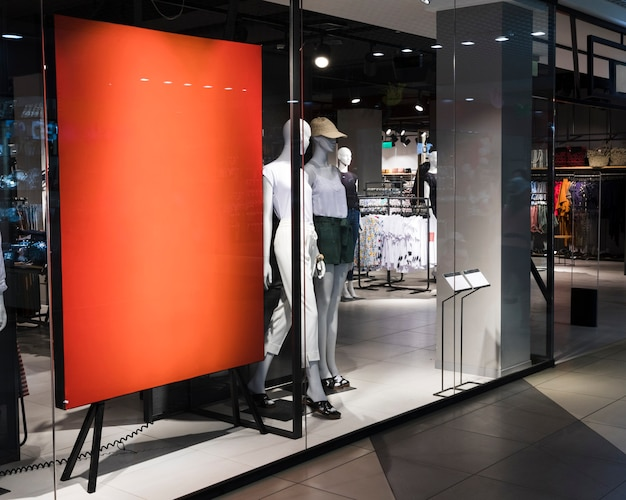 Empty orange sign in clothing store Free Photo