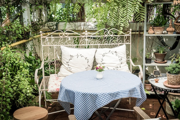 Empty outdoor patio table and chair decoration in garden Premium Photo
