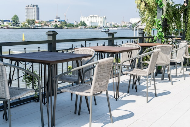 Empty outdoor patio table and chair in restaurant Premium Photo