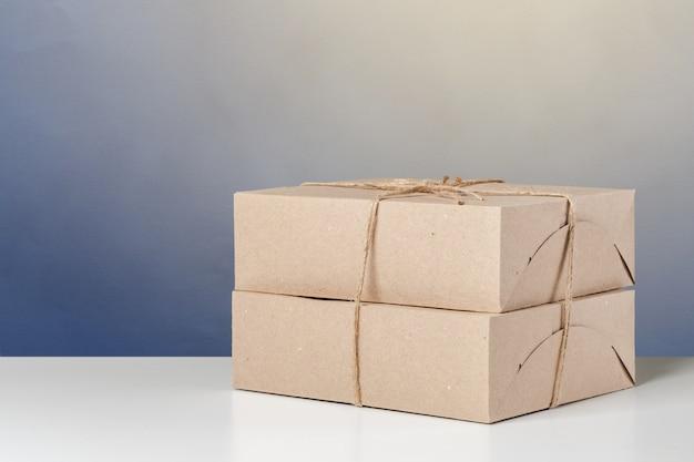 Empty paper box on a table Premium Photo