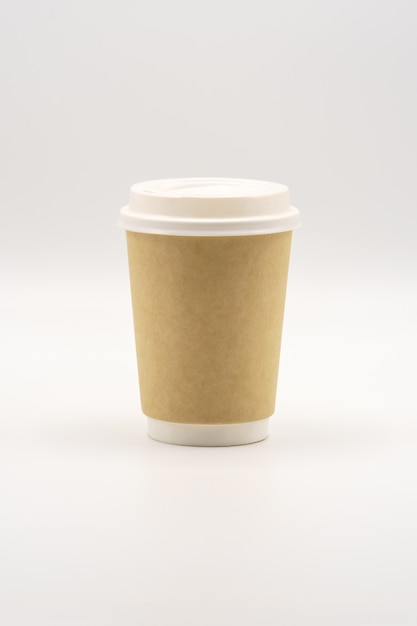 Empty paper cup with white lid, place for logo Premium Photo